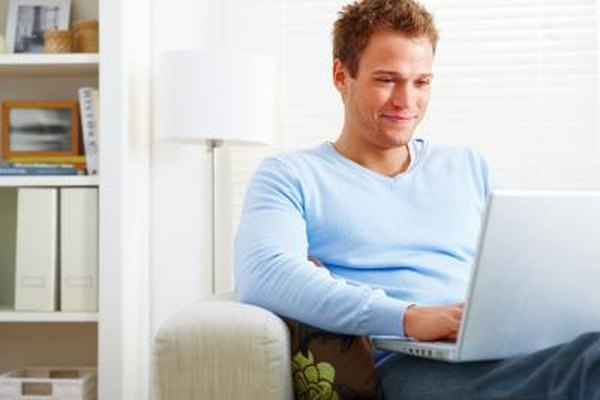 Man looking up Kelley Blue Book values online