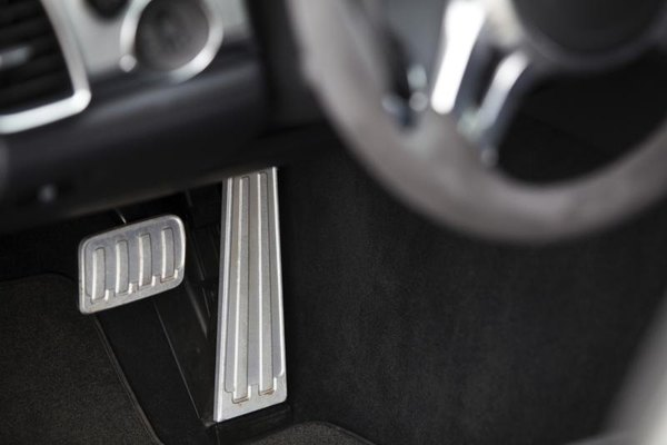 A brake and accelerator pedal in a car.