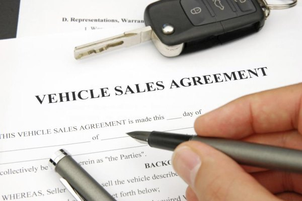 Person signing vehicle sale agreement