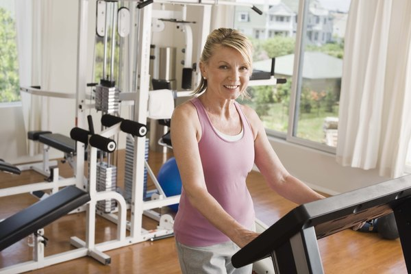 Woman on treadmill in home gym
