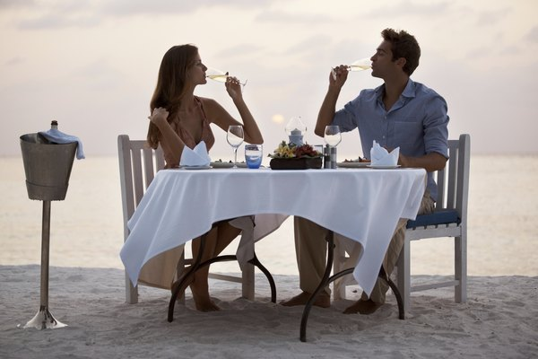 Beautiful couple enjoying a romantic dinner at the beach