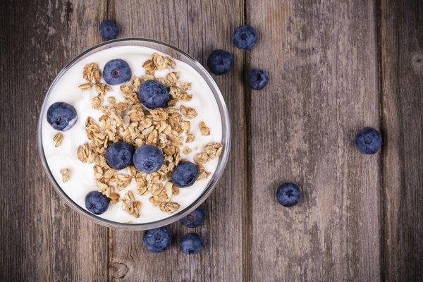 Yogurt with granola and blueberries.