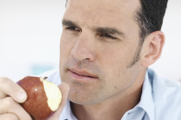 Man holding apple, close up