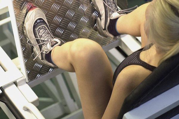 High angle view of a young woman exercising in a gym