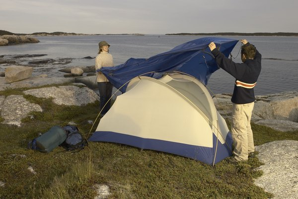Couple setting up campsite