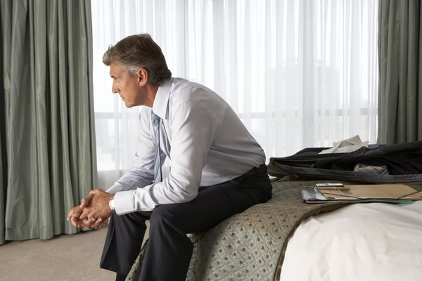 business man sitting on a hotel bed