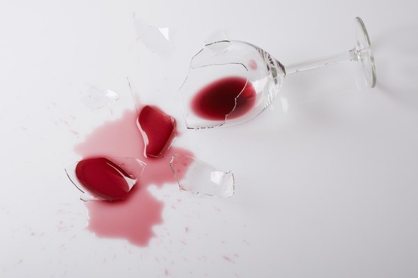 Spilled red wine and glass