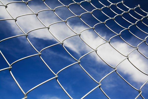 Chain linked fence against blue sky