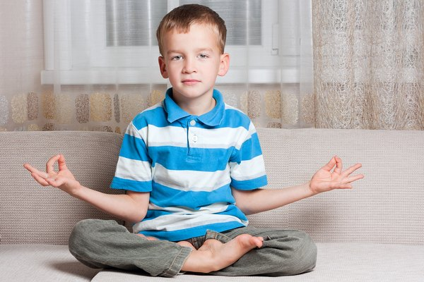 Boy sits in a lotus position.