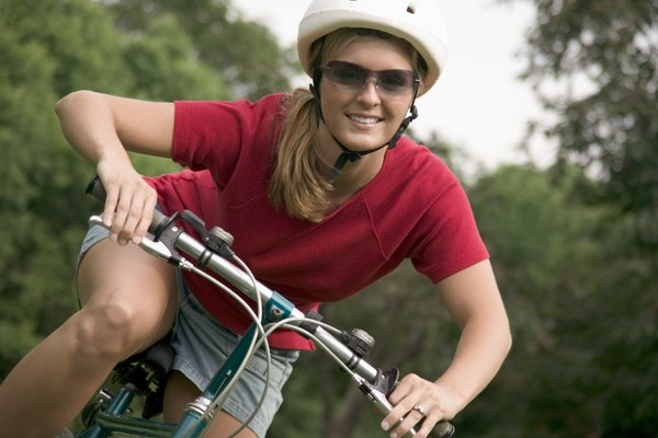 Woman wearing helmet on bicycle