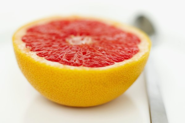 close-up of half of a grapefruit with a spoon