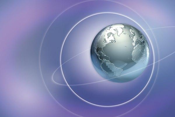 Un globo terráqueo plateado en el espacio representa la física.