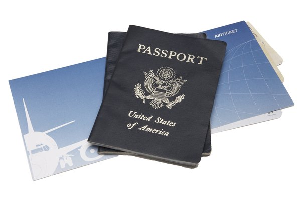 Two passports atop airline tickets