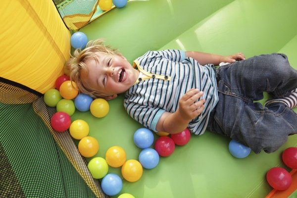 Child on inflatable bouncy castle