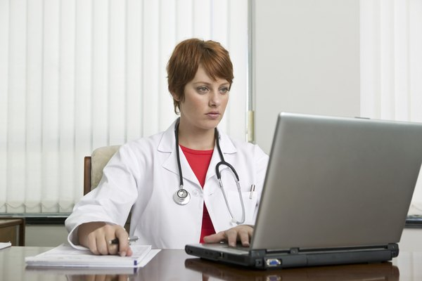 Doctor working on laptop