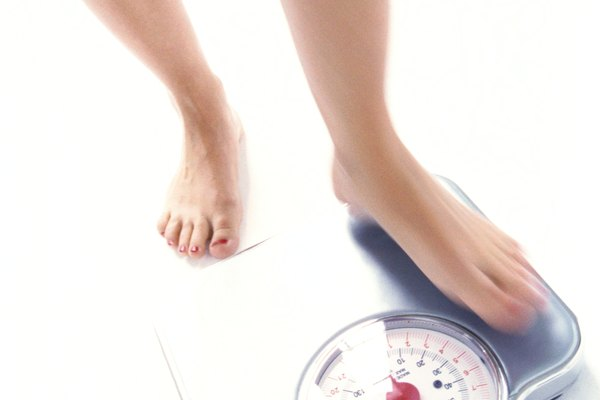 high angle view of woman's feet on a weighing scale