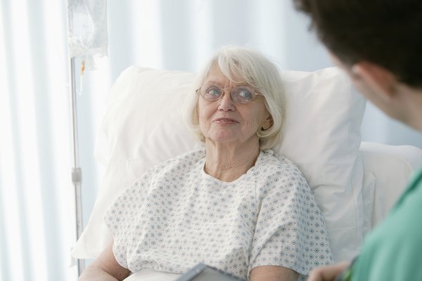 Patient talking to physician at hospital
