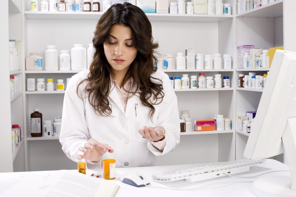 Pharmacist holding pill