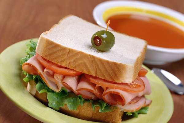 A close-up of a sandwich and a bowl of soup