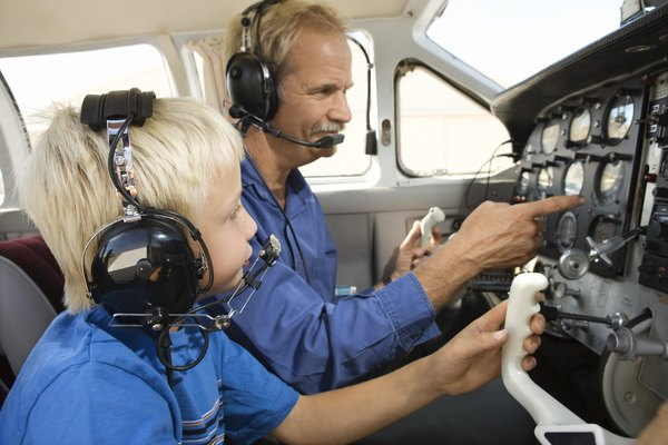 Father showing son airplane controls
