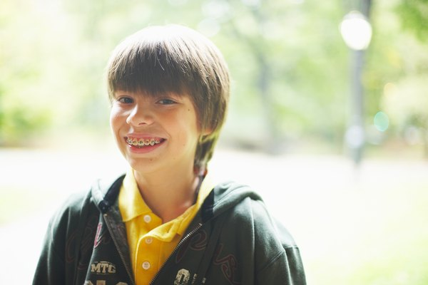 Outdoors portrait of smiling boy with braces