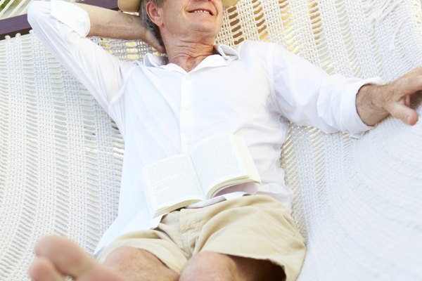 Senior Man Relaxing In Beach Hammock
