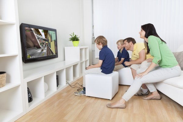 A family plays video games downloaded on a console.