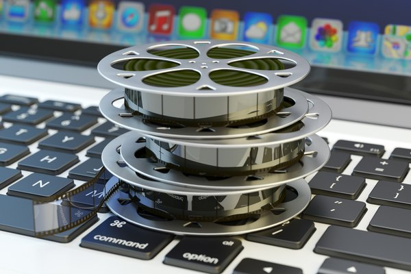 Film reels on a computer keyboard, which represents the concept of ripping movies.