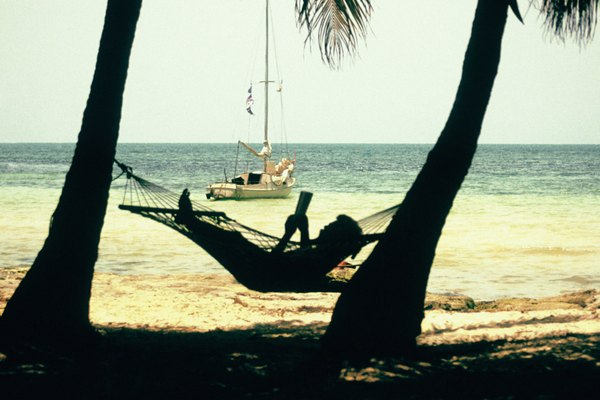 Woman reading on hammock on George Smathers Beach in Key West, Florida, USA