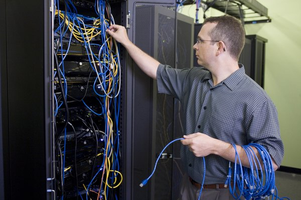 A technician services a computer server