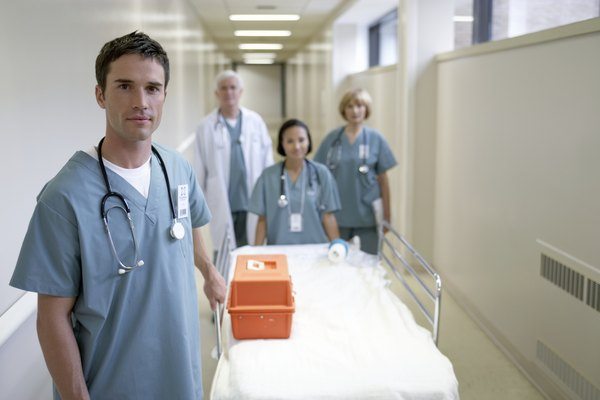 Doctors with hospital trolley walking in corridor