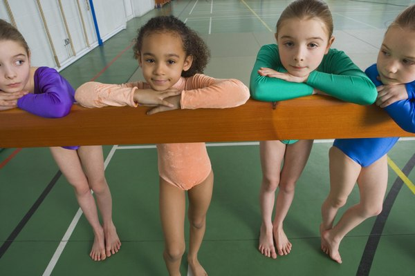 Gymnasts posing on balance beam