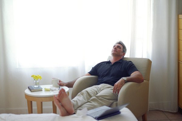 Man relaxing with his feet up