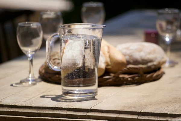 Bread and water on picnic table