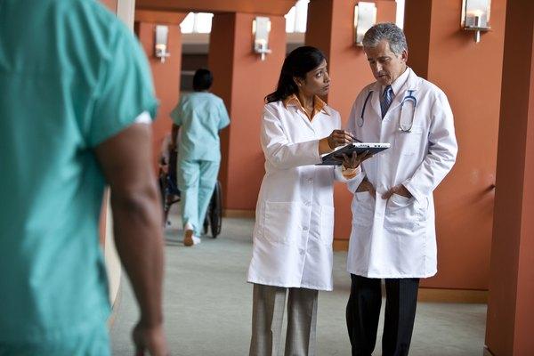 two doctors talking in hallway
