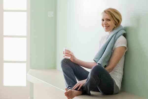 Woman resting with glass of water