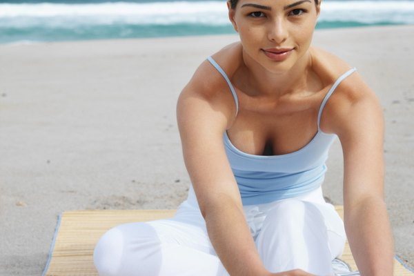 Front view of a woman exercising on the beach