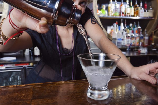 Bartender pouring a cocktail