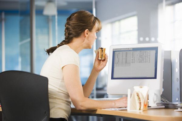 Office worker eating at desk