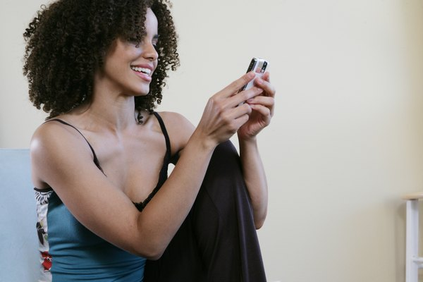 A young woman holding an iPod Touch