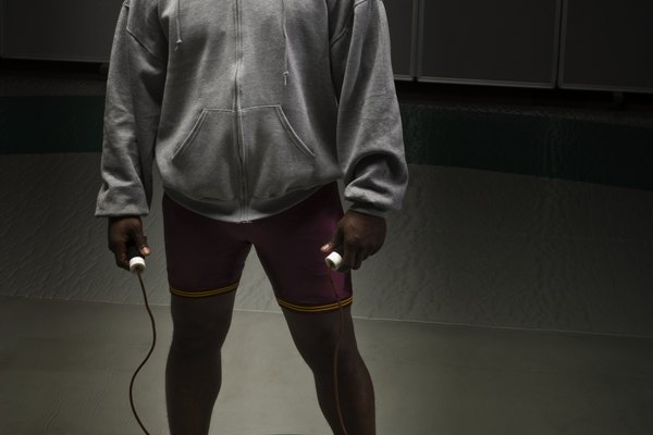 Wrestler in hooded top, holding skipping rope, portrait