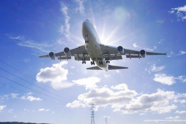 Airplane flying under sunlight