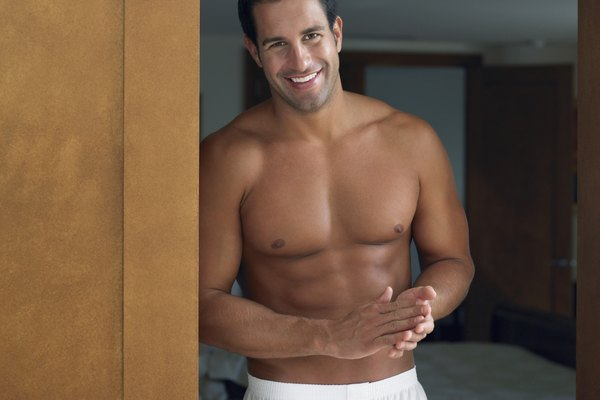Man in His Boxer Shorts Standing in Bedroom Door