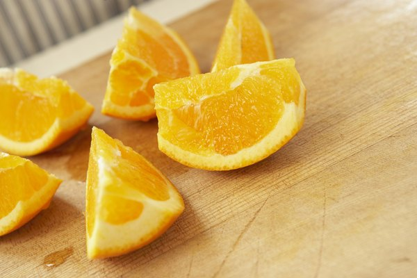 Sliced oranges on cutting board, close up