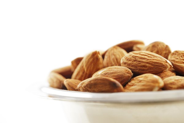 Bowl of almonds on a white background