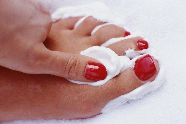 Woman applying cream to foot