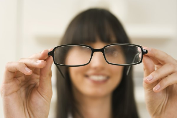Woman holding eyeglasses