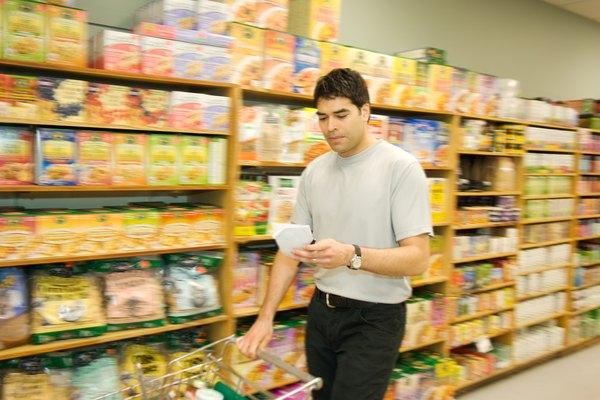 Man checking list and pushing shopping cart