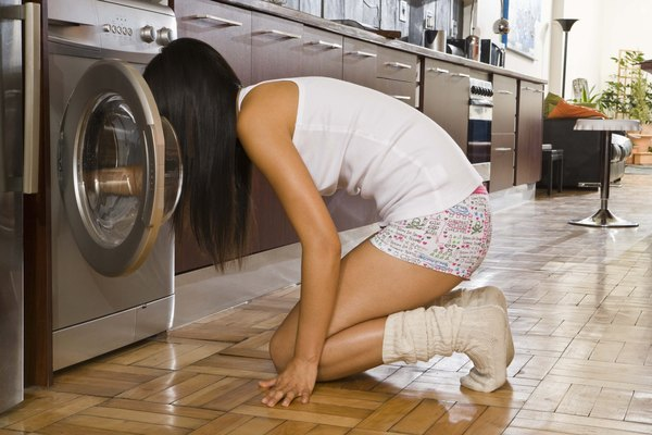 Woman unloading clothes dryer