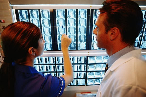 Doctor with nurse viewing MRI scan results